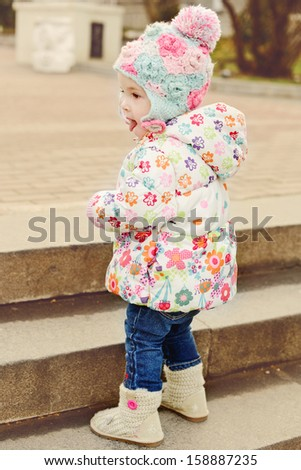 baby girl trying to walk staircase  - stock photo