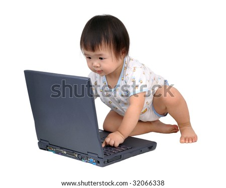 baby girl typing on a laptop computer