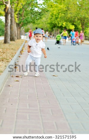 baby girl walking by the street her first steps - stock photo