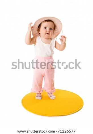 Baby girl wearing panama standing on carpet isolated - stock photo