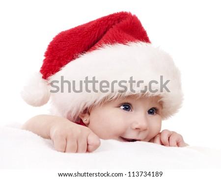 baby girl wearing santa hat on white isolated background - stock photo