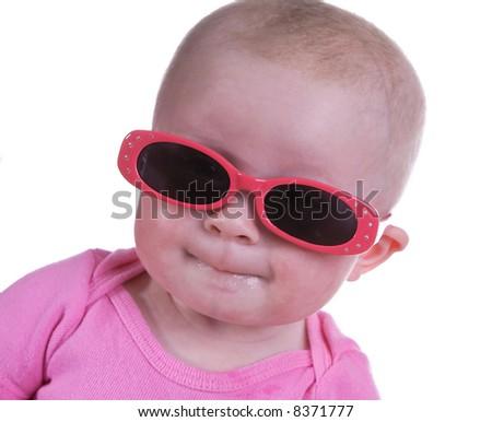 Baby girl wearing sunglasses - stock photo