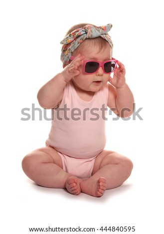 Baby girl wearing vintage floral headband and sunglasses cutout - stock photo