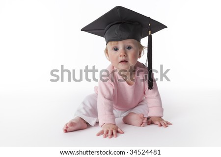 Baby girl with a graduation cap - stock photo