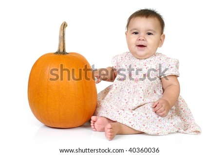 baby girl with a pumpkin, isolated on white background