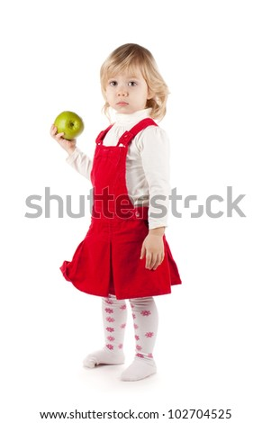 Baby girl with apple. Isolated on white background