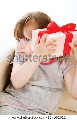baby girl with big gift box - stock photo