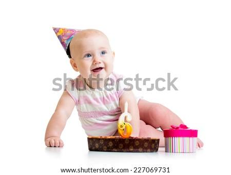 baby girl with birthday cake isolated on white - stock photo