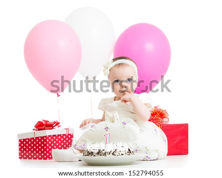 baby girl with cake and gifts isolated on white - stock photo