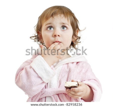 baby girl with candy - stock photo