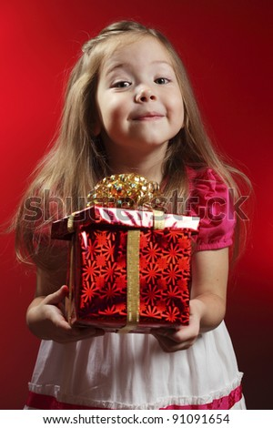 Baby girl with Christmas gift - stock photo