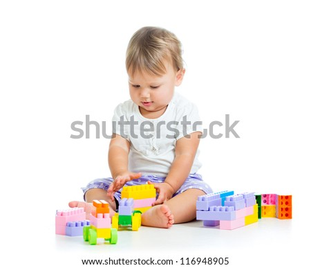 baby girl with construction set isolated on white background - stock photo