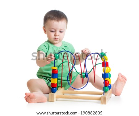 baby girl with educational toy - stock photo