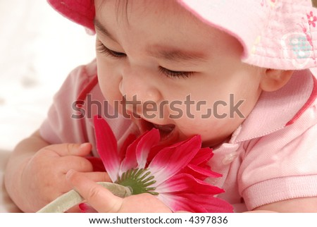 baby girl with flower - stock photo