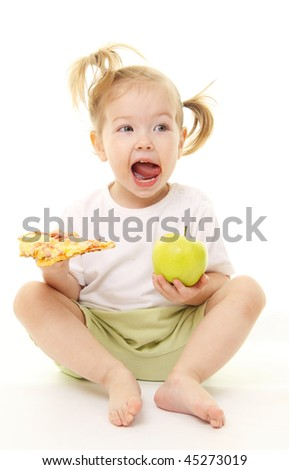 Baby girl with green apple and pizza - stock photo