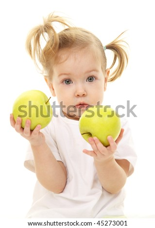 Baby girl with green apples - stock photo