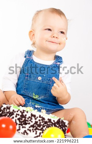 baby girl with hat and cake  - stock photo