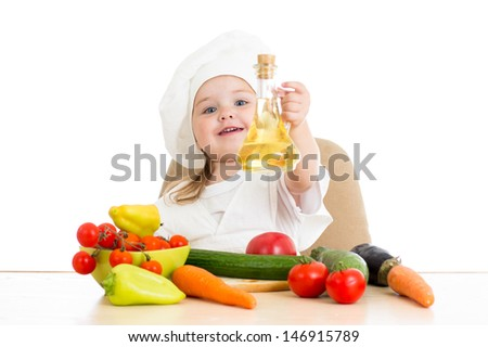 baby girl with healthy food vegetables and sunflower oil - stock photo