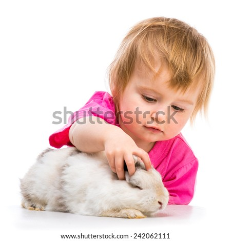 baby girl with her small white rabbit isolated on white background - stock photo