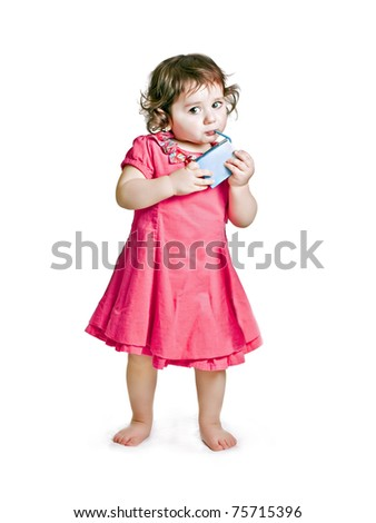 baby girl with juice - stock photo