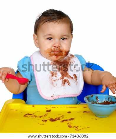 Baby girl with messy chocolate pudding face, one year old, isolated on white background - stock photo