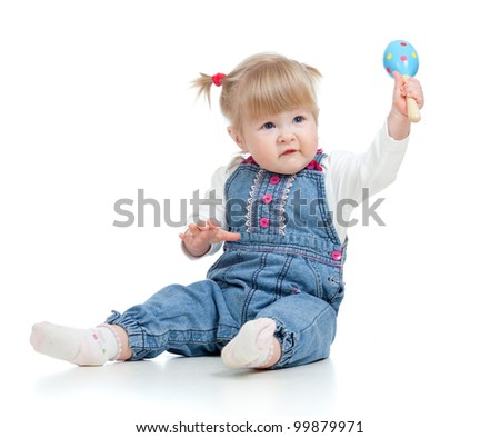 Baby girl with musical toys. Isolated on white background - stock photo
