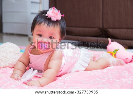 baby girl with pacifier,