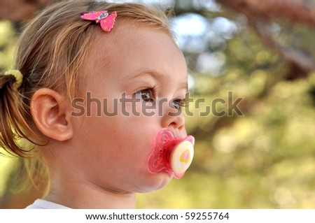 baby girl with pacifier - stock photo