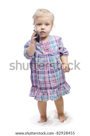 baby girl with phone - stock photo