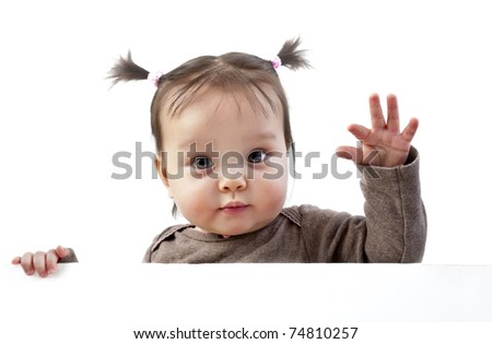 Baby girl with pigtails waving hand above white banner - stock photo