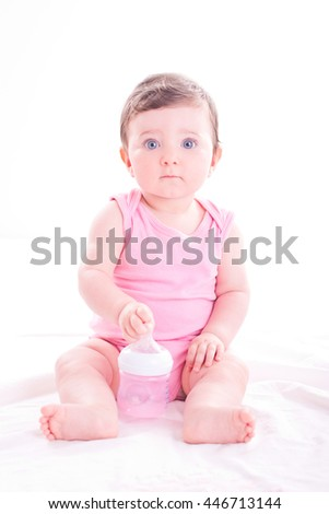 stock-photo-baby-girl-with-pink-baby-bot