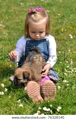 baby girl with puppy