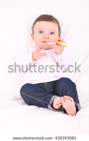 Baby girl with spoon.