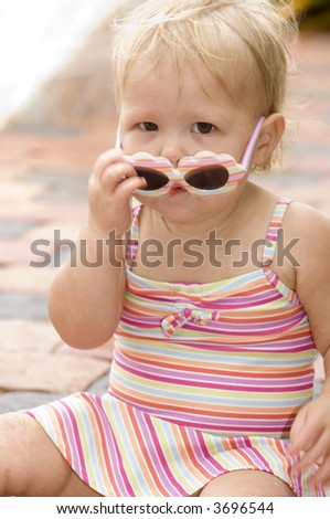 Baby Girl with Sunglasses in Swimsuit - stock photo