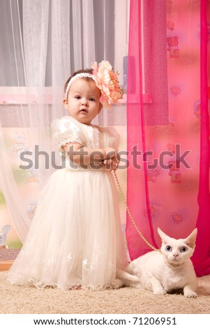 baby girl with the cat - stock photo