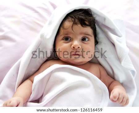 baby girl with towel - stock photo