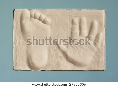 baby hand and foot print in gypsum - stock photo
