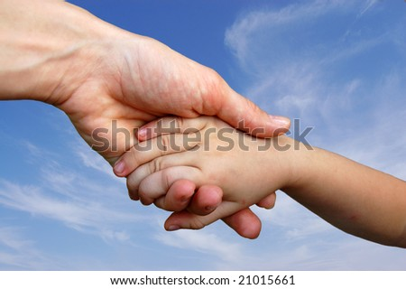 Baby hand and Mother hand on sky background - stock photo