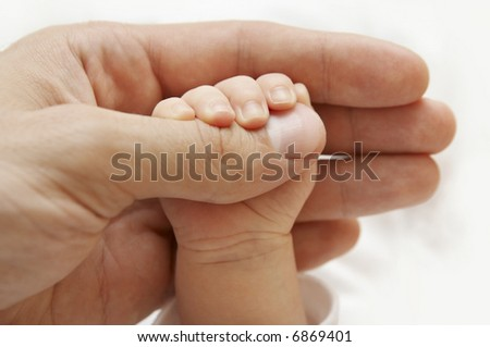 Baby Hand, Father Hold New Born Kid, Parent Touch Newborn Child, Family Help Care Concept - stock photo
