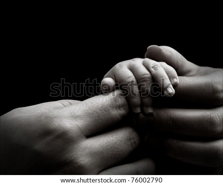 Baby hand holding mother's hands - stock photo
