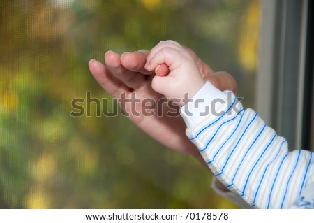 baby hand in hand the mother close up - stock photo