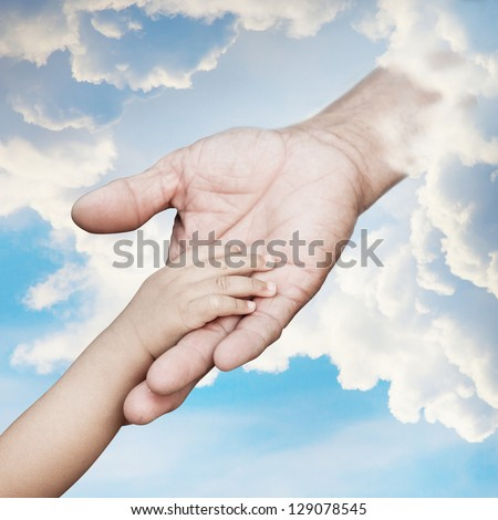 Baby hand reach out to god - stock photo
