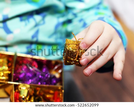 Baby hand with Christmas gift