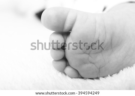 Baby hands and feet - stock photo