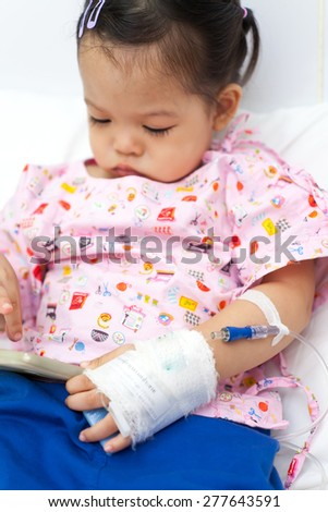 Baby have diarrhea and sitting on a bed in hospital with saline intravenous (iv) - stock photo