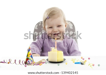 baby having her first birthday, isolated on white background