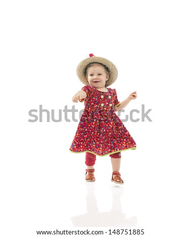 baby her first steps, isolated on white - stock photo