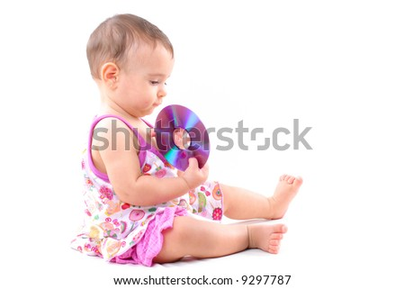 Baby holding a CD or DVD media .