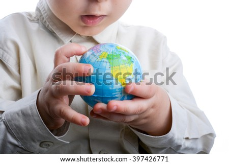 Baby holding a small globe in hand on white background
