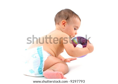 Baby holding an CD or DVD media .